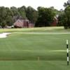 A view of a green flanked by bunkers at Southern Hills Golf Club.
