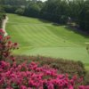 A view of green #9 surrounded by flowers atBerkeley Hills Country Club