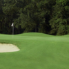 A view of a green flaked by bunkers at Griffin Bell Golf & Conference Center
