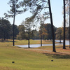 A view of a green surrounded by water at Gordon Lakes Golf Course
