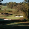 A view of a green protected by bunkers at Chimney Oaks Golf Club