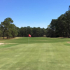 A sunny day view of a green at Evans Heights Golf Club.