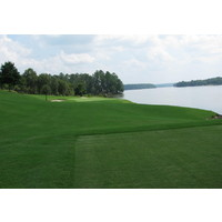 The fourth hole on the Bluff nine at Reynolds Plantation's National course uses Lake Oconee as a right side water hazard.