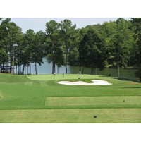 The third hole on the Cove nine at Reynolds Plantation's National golf course is a par 3 in front of Lake Oconee.